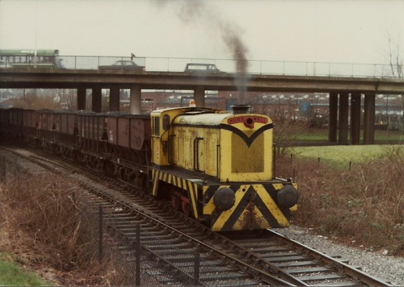 The Western Fuel Company Hudswell pilot (ex PBA No. D1171) takes the loaded hoppers to Wapping Wharf, 11:2:80.