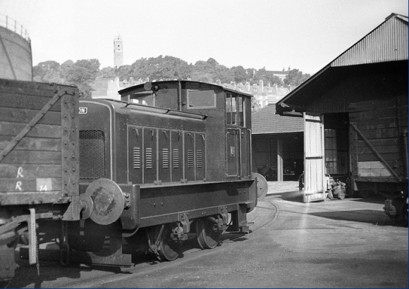 An unidentified 4 wheel diesel mechanical built by Ruston, potters around the Bristol Gas Company's works at Canon's Marsh, note Bristol's famous Cabot Tower on the skyline. 7/52. ©www.railphotoprints.co.uk - collection