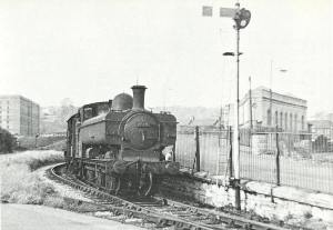 Ex-GWR 0-6-0 pannier tank, No. 9729, swings around the curve near Ashton Swing Bridge North signal box and heads towards Wapping along the New Cut with a freight train in 1960.