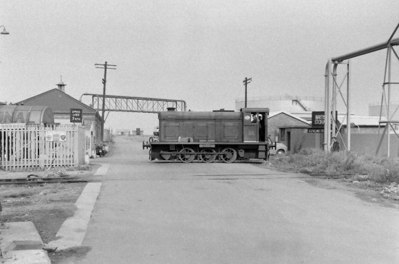 'Merlin' light engine on level crossing 8/9/1956 (Courtesy Transport Treasury/Eric Sawford Collection)