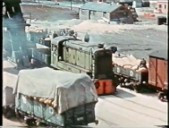 An unidentified Hudswell Clarke at Avonmouth, sporting the early green livery and raised PBA lettering. This example has a long box on the running board so is possibly 'Tintagel' (screenshot from 'Bristol - Port of Many Trades', property of Bristol Museums)