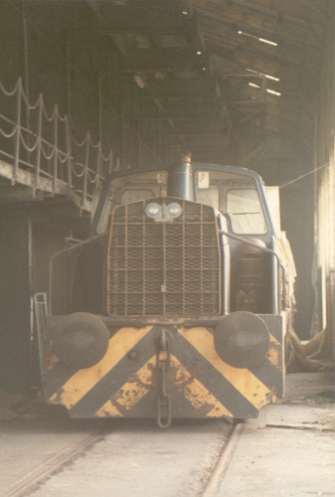 PBA 39 in store at Avonmouth Docks in 1983 after the internal railway system had been closed. The PBA fleet of eight Rolls Royce Sentinel locomotives were in this open sided warehouse and covered by tarpaulins. No 39 was suggested to be the best of the eight and an inspection was arranged.