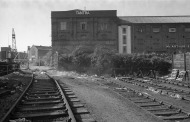 Amazingly most of the buildings in this photo are still extant. The TANTRA building is derelict and covered by sheeting as of 2018. The line on the left heads toward Albion Dockyard, and bits of track in the concrete can still be seen today. 16th September 1979 (Tim V)